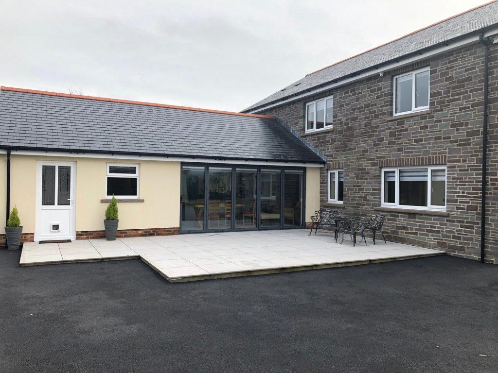 Capel Hendre, Ammanford, Carmarthenshire RAL 7016 grey Aluminium bifold door & white uPVC windows