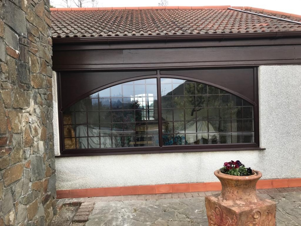 Jersey Marine, uPVC Rosewood Arched Window