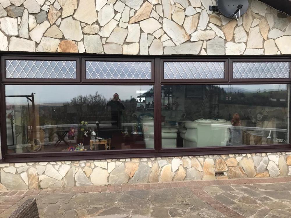 Jersey Marine, uPVC Rosewood window with Diamond lead glass