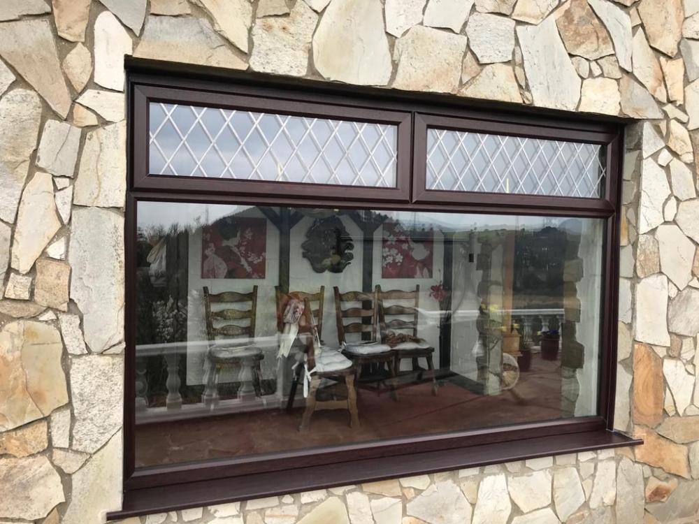 Jersey Marine, uPVC Rosewood window with diamond leaded glass
